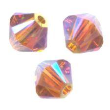 15 Perles Toupies 4mm Cristal Swarovski  - TOPAZ AB2X
