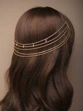 Gilt and crystal hair chains on combs