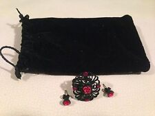 Black & red ring & stud earrings set in a pouch