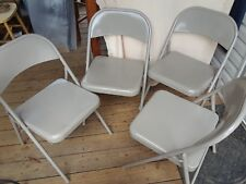 (4) TAN METAL FOLDING CHAIRS BY MECO