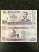 IRAG DINAR SADDAM HUSSEIN 10,000 IRAQI NOTE UNCIRCULATED WITH THE SILVER STRIP !