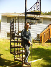 """The Spiral Staircase kit . It is 58"""" diameter cedar wood on the steps.In stock."""