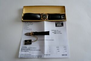 UNIVERSAL GENEVE MEN'S 10K GOLD AUTOMATIC WATCH, BLACK FACE - C1967, PERIOD BOX