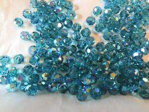 48 Swarovski round crystal beads in 6mm Indicolite AB. #5000