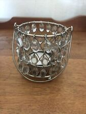 Votive silver and glass candle holder.