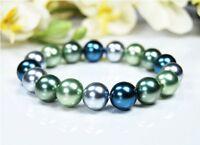 Schönes Armband aus Muschelkernperlen Farbe Blau-Silber-Grün