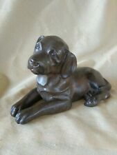 Bronze lost wax Lab Puppy laying down Sculpture