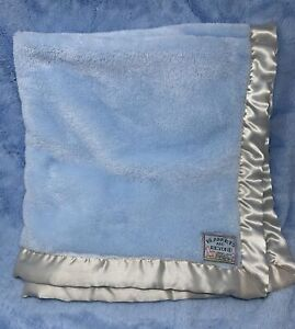 Blankets and Beyond blue plush baby blanket with silver satin edge border