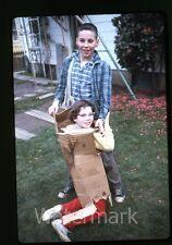 1960s 35mm ektachrome Photo slide teen boy with girl in box