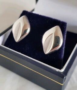 A pair of 18ct White gold stud earrings.Of naturalistic design.Sheffield 2001