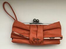 Nice! Jessica Simpson Orange Lock Wristlet Bag Hand Carry/Clutch Under Arm Purse