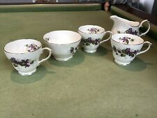 Duchess Violets bone china tea set. 3 Cups, 1 Milk Jug And 1 Bowl
