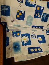 Shower curtain white w Yellow and blue flower design. Famous home furnishings