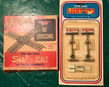 Vintage Atlas Ho 90 Track Crossing & Light up Exxon Signs