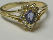14K  SOLID GOLD TANZANITE AND DIAMOND( 0.12CT) RING SIZE 7,25+