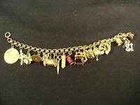 Ladies 14 K Gold Charm Bracelet, 16 Assorted Theme Charms, 48 Grams