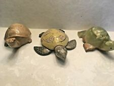 Group of three stone hand carved turtles