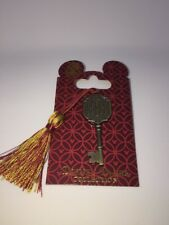 Disney  Tower of Terror Key Is A Bronze Key With A Red And yellow Colored tassel