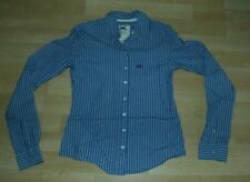Women's fitted shirt. Gilly Hicks. Size XS. Blue with white and navy stripe.