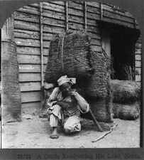 Photo:A coolie readjusting his load,Korea,December 16,c1926,man,hay 5269