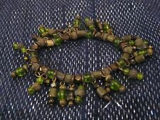 Lovely elasticated bracelet with wonderful moss green beads & bronze tone metal