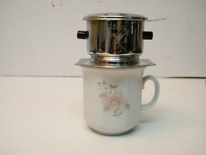 ONE SERVICE DRIP COFFEE MAKER ON THE CUP