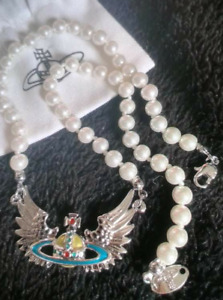 Vivienne Westwood  pearl angel wings necklace.VW box,pouch,card.