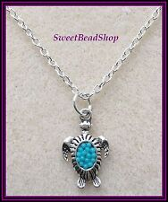 Silver Plated Necklace with Silver Coloured Turtle Charm - Turquoise Bead Detail