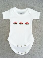 Gorgeous short sleeved babygrow with red car details (Newborn size)
