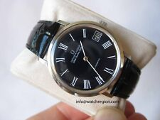 UNIVERSAL GENEVE WHITE SHADOW DATE AUTOMATIC MICRO ROTOR BLACK ROMAN DIAL WATCH