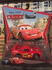 Disney Pixar Cars 2 Lightning Mcqueen with Racing Wheels Mattel 1.55 Scale BNIB
