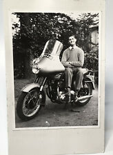 Vintage Motorcycle photo with sitting man