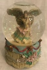 Angel Playing the Flute Snow Globe