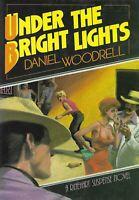 UNDER THE BRIGHT LIGHTS DANIEL WOODRELL 1ST PRINTING HCDJ