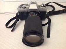 Minolta X-300 35mm with tokina sz-x 60-300mm lens