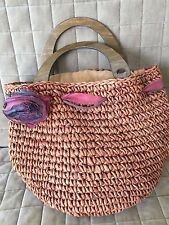 Used straw bag with flower ribbon