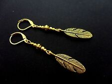 A PAIR GOLD COLOUR DROP DANGLY FEATHER THEMED LEVERBACK HOOK EARRINGS. NEW.