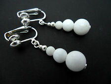 A PAIR OF PRETTY WHITE JADE BEAD  SILVER PLATED  CLIP ON   EARRINGS. NEW.
