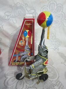 Schylling Elephant on Bike Wind Up Tin Toy Ball Tassels in Box