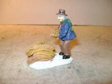Cute Holiday Time Village Collectible Man Gathering Hay or Straw