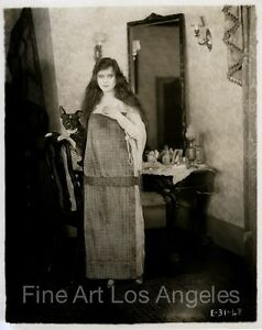 Photo of Theda Bara and a dog