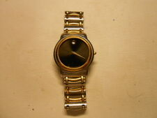 VINTAGE MOVADO QUARTZ.EXCELLENT CONDITION-SS TWO TONE/BLABK DIAL.SWISS MADE