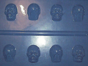 FOUR SMALL 3 DIMENSIONAL SKULL SHAPES HALLOWEEN CHOCOLATE MOULD