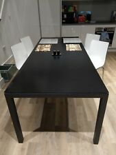 Large black dining table (glass-top) 220cm/92cm and chairs, seats 10 people.