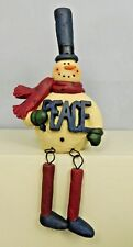 Sitting snowman with dangling legs and Peace on him - New Blossom Bucket#80590B