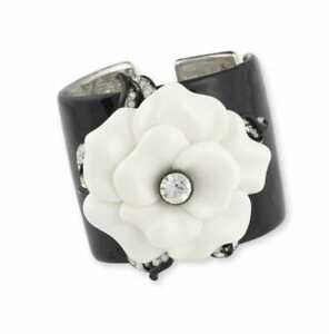 KENNETH JAY LANE, BLACK ENAMEL CUFF WITH WHITE FLOWER ACCENT
