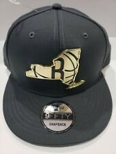 New Era Dark Grey Brooklyn Nets Gold Metal Badge Logo NBA 9Fifty Snapback Hat