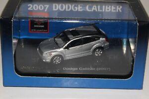 RICKO DIECAST #38569 2007 DODGE CALIBER, SILVER, 1:87 HO SCALE, NIB