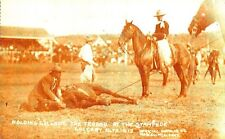 CT61. Postcard.Calgary Stampede. Alta 1912. Rodeo.Holding Cyclone - a horse.