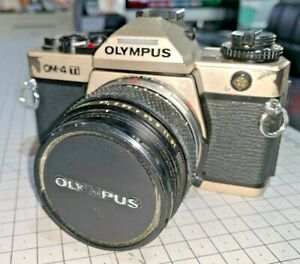 Olympus OM-4 Ti  SLR in Champagne, with Zuiko S 50mm f1.4, Case, Manuals & Strap